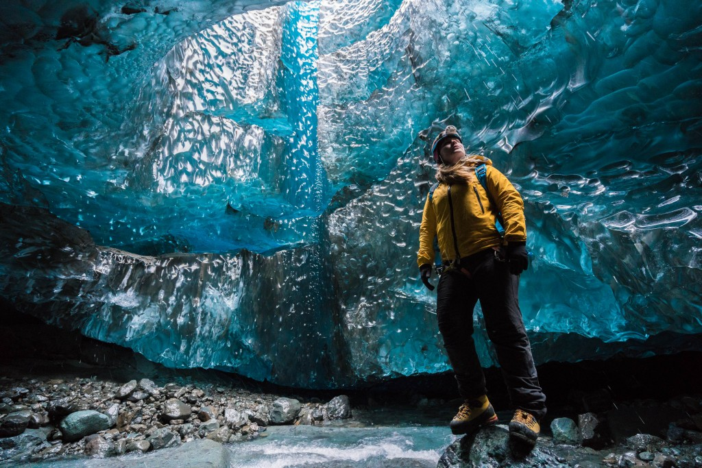 Wednesday 25th November 2015, Vatnajökull national park, Iceland: Photographer Mikael Buck with assistance from renowned local Icelandic guide Einar Runar Sigurdsson, explored the frozen world of Vatnajökull glacier in Iceland using Sony's world first back-illuminated full-frame sensor – which features in the ?7R II camera. His images were taken without use of a tripod or any image stitching techniques in photoshop. This was made possible through Sony's new sensor technology, allowing incredibly detailed low-light hand held photography. Previously images this detailed would have required carrying bulky equipment to the caves, some of which can require hiking and climbing over a glacier for up to two hours to to access. This picture: Guide Helen Maria is pictured inside the waterfall cave PR Handout - editorial usage only. Photographer's details not to be removed from metadata or byline. For further information please contact Rochelle Collison at Hope & Glory PR on 020 7014 5306 or rochelle.collison@hopeandglorypr.com Copyright: © Mikael Buck / Sony 07828 201 042 / mikaelbuck@gmail.com